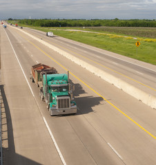 Teal Semi Truck Trailer Rig Hauls Freight on Divided Highway