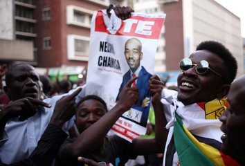 Supporters of the opposition Movement for Democratic Change party (MDC) of Nelson Chamisa, sing and dance in the street outside the party's headquarters following general elections in Harare