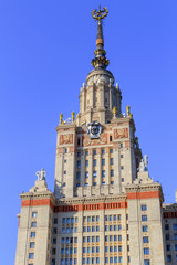 Tower of Lomonosov Moscow State University (MSU) in sunny summer evening on a blue sky background