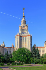 View of Lomonosov Moscow State University (MSU) against blue sky in sunny summer evening
