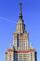Tower of main building of Moscow State University (MSU) against blue sky in sunny summer evening