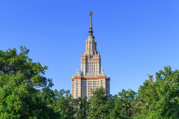 Moscow State University (MSU) on a blue sky background in sunny summer evening