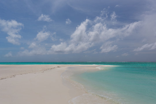 Lonely beach in the Caribbean on a sunny summer day with an almost cloudless sky No. 2