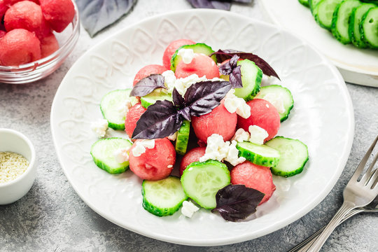 Watermelon cucumber feta salad with balsamic dressing. Selective focus, copy space.