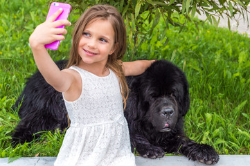 child takes pictures of himself and the dog