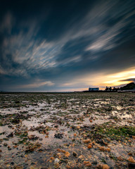 stormy sunset at low tide
