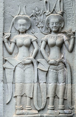 Carvings of Apsaras (spirit of the clouds and waters in Hindu and Buddhist culture) on the exterior of a temple at Angkor, UNESCO World Heritage Site, Siem Reap, Cambodia, Indochina, Southeast Asia, Asia