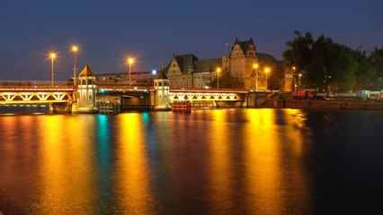 Szczecin. night view of the historic long bridge over the Odra river.