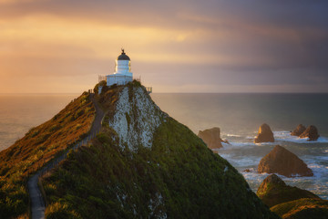 Nugget Point Lighthouse at sunrise, Nugget Point, Otago, South Island, New Zealand, Pacific
