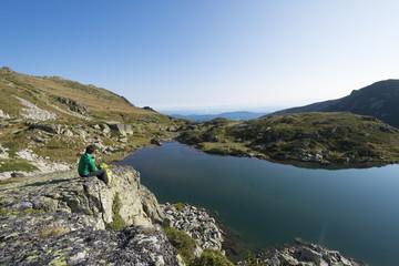 Hiking next to one of the Maliovitsa lakes in the Rila Mountains, Bulgaria, Europe