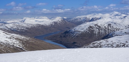 Looking down to Loch Lyon and Glen Lyon from the summit ridge of Beinn Dorian in the Scottish Highlands, Scotland, United Kingdom, Europe