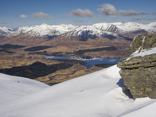 Loch Tulla and the snow capped Blackmount viewed from Beinn Dorian near Bridge of Orchy in the Scottish Highlands, Scotland, United Kingdom, Europe
