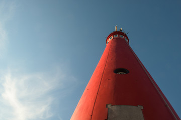 The red North Tower lighthouse on the Dutch island Schiermonnikoog, The Netherlands