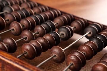 antique abacus on a wooden table close up