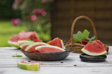 slice Watermelon on the table in garden