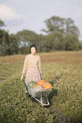 Blurred woman with pumpkins