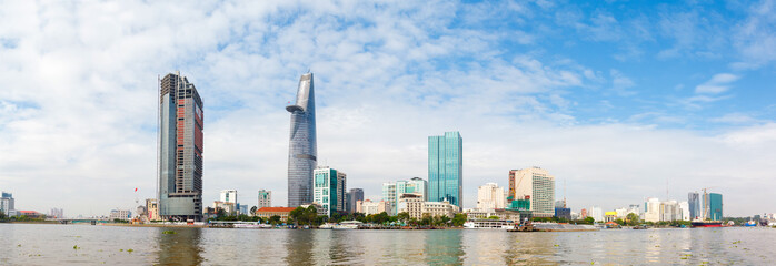 skyscrapers business center in Ho Chi Minh City on Vietnam Saigon on background blue sky. view of the business center from the river