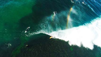 Surfing in wavy ocean