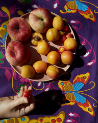 Summer fruit plate with hand