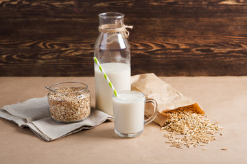 glass of  vegan oat milk and Oat on a table, space for text.