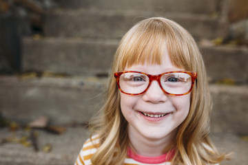 Portrait of a smiling Young Girl with Glasses
