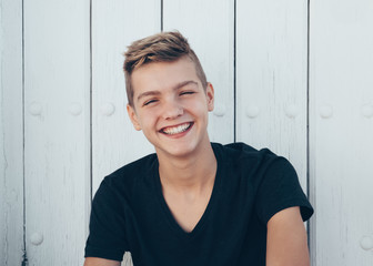 Laughing teen posing at camera