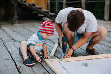 Man and son busy with carpentry