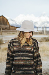 Woman Wearing Sweater Looking to the Side