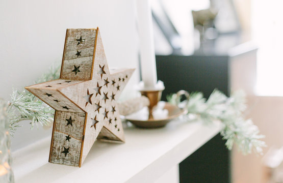 Christmas decor on a stone mantelpiece.