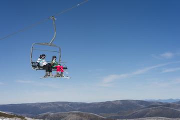 two girls on a ski lift