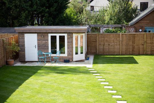 Timber home office building in a suburban garden