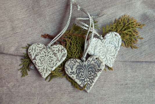 Vintage christmas handmade ornaments hearts from polymer clay.White and silver romantic hearts.