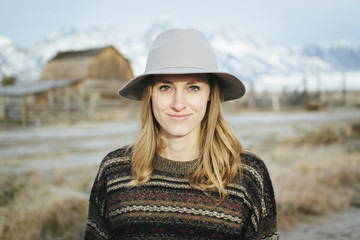 Closeup of Happy Smiling Woman Wearing Sweater and Hat