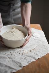 Baker kneading dough for artisan bread