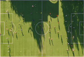 Aerial view of teenagers playing football