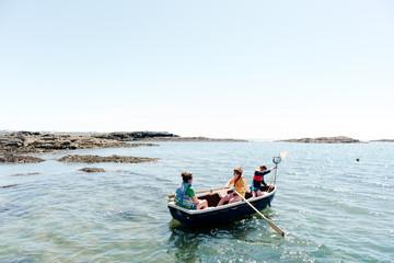 kids on rowboat at sea