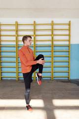 Sportsman warming up in gym