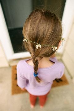 little girl with clover flower headband