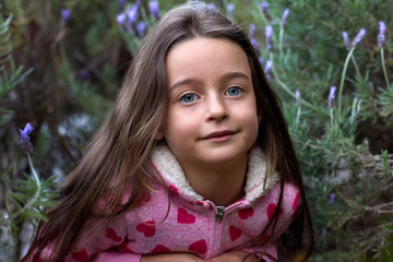Portrait of young innocent girl in lavendar  flowers