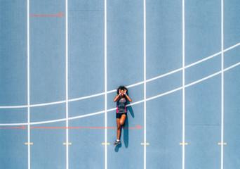 Black athlete woman on a race track