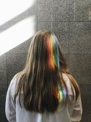Rainbow on woman's hair