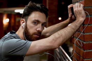 Sportsman listening to music