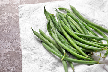 Pile of fresh green French beans on table