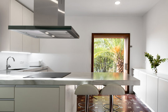 Modern kitchen with typical old floor in a country house, Spain