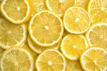 Slices of fresh juicy lemons as background