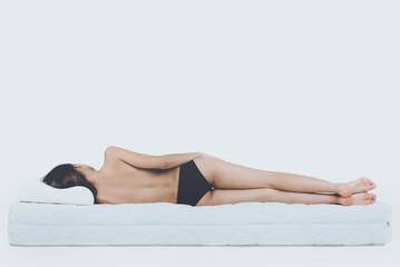 Young Bare Woman Lying on Orthopedic Mattress