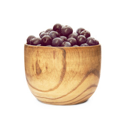 Bowl with fresh acai berries on white background