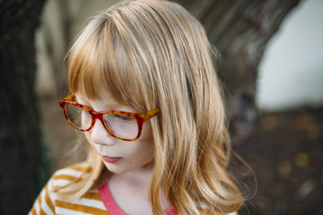 Little Girl with Glasses Outside