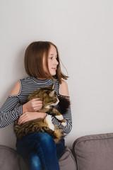 tween girl holding her cat