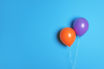 Different balloons on color background. Celebration time